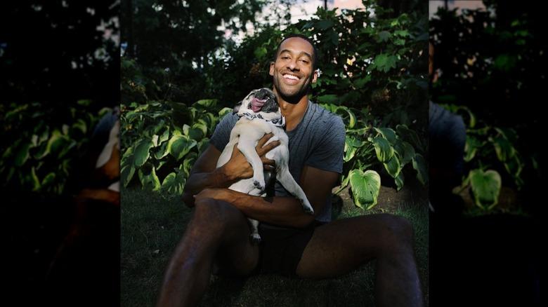 Matt James snuggles with his pug