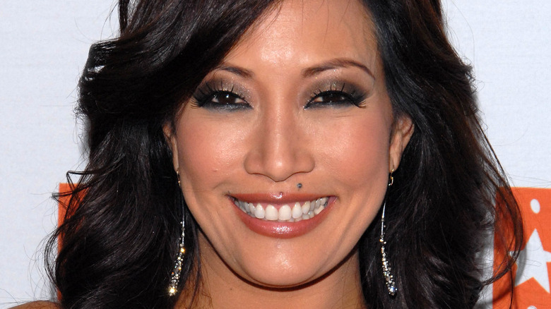Carrie Ann Inaba smiling at an event