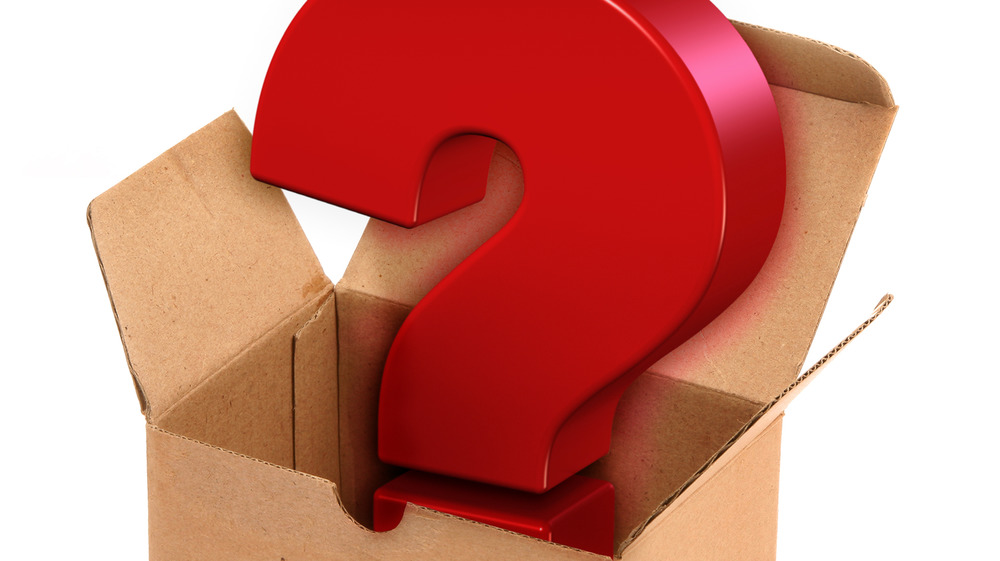 Cardboard box with red question mark inside.