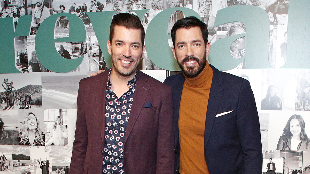 Jonathan and Drew Scott smile together