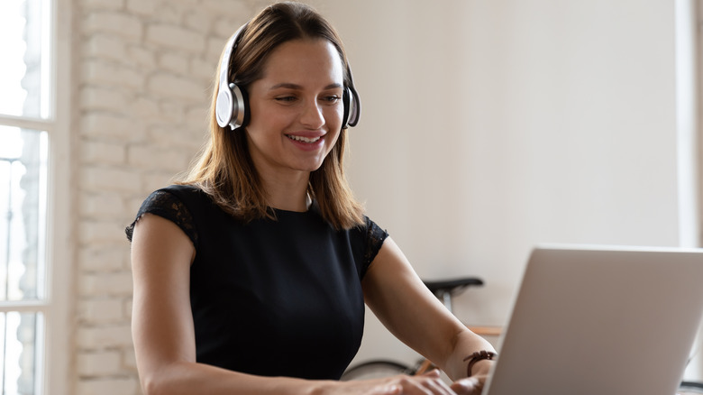 Woman listening to music at work