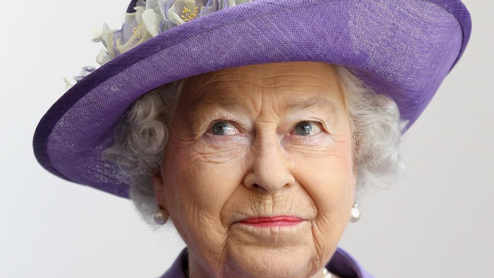 Queen Elizabeth II in purple hat