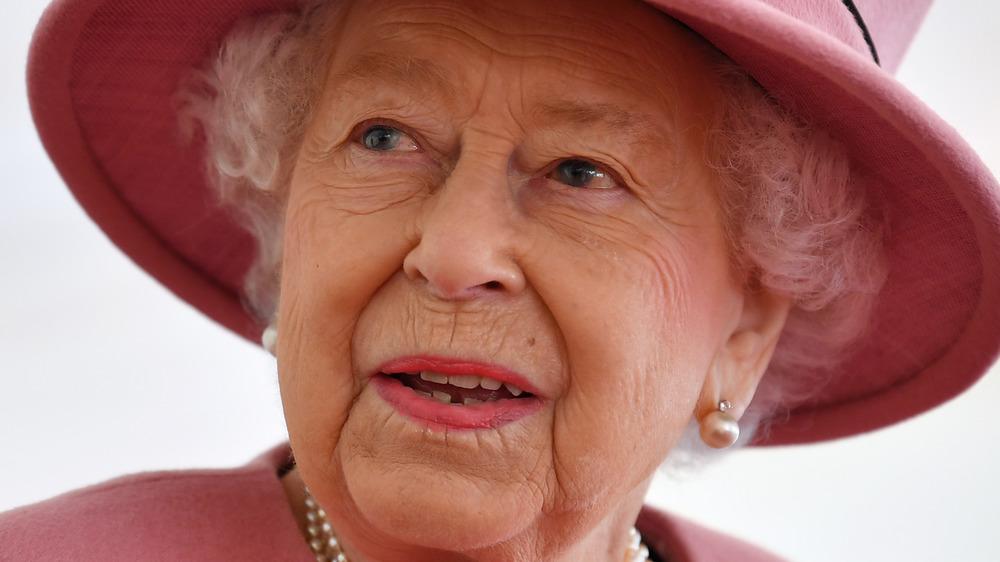 Queen Elizabeth II in pink hat