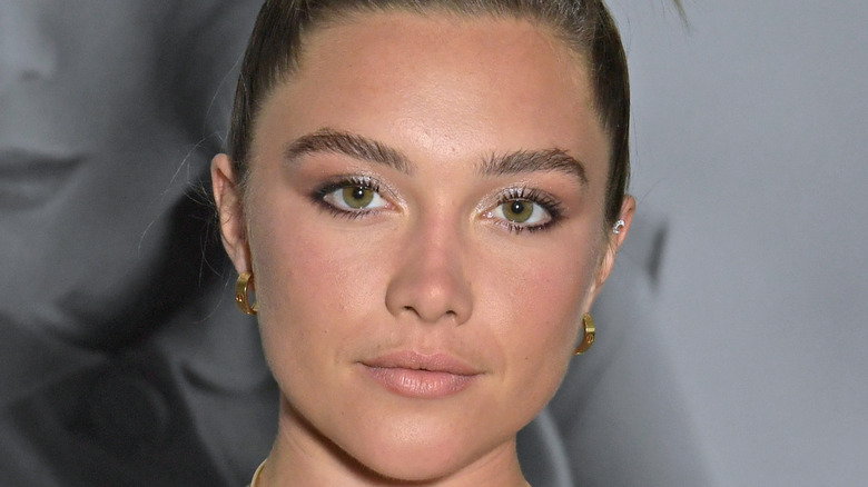 Florence Pugh poses for a picture at an event