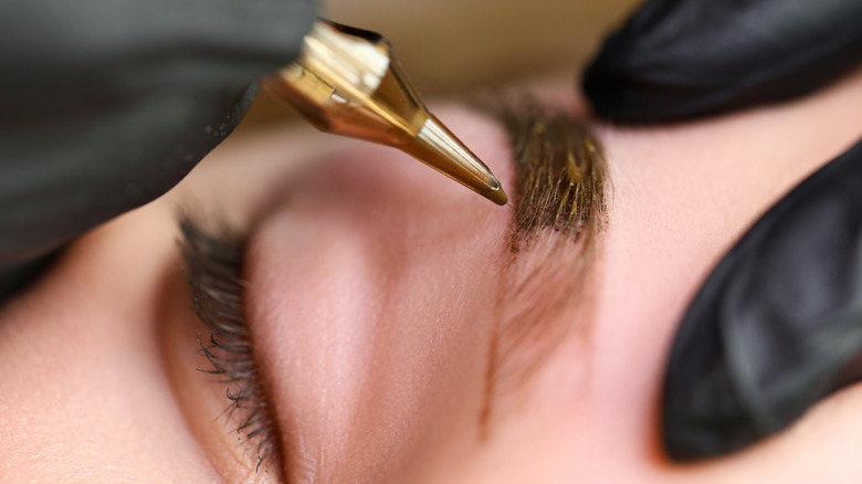 A woman getting microblading