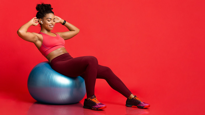 Woman exercising with an exercise ball