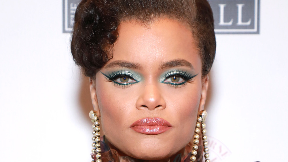 Andra Day looking serious in dramatic makeup