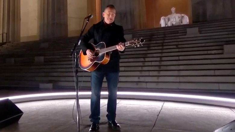 Bruce Springsteen at inauguration concert holding guitar