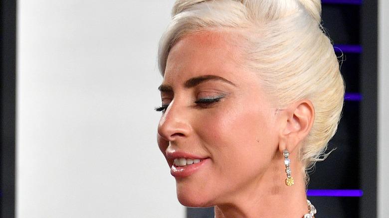 Lady Gaga staring at her Oscar