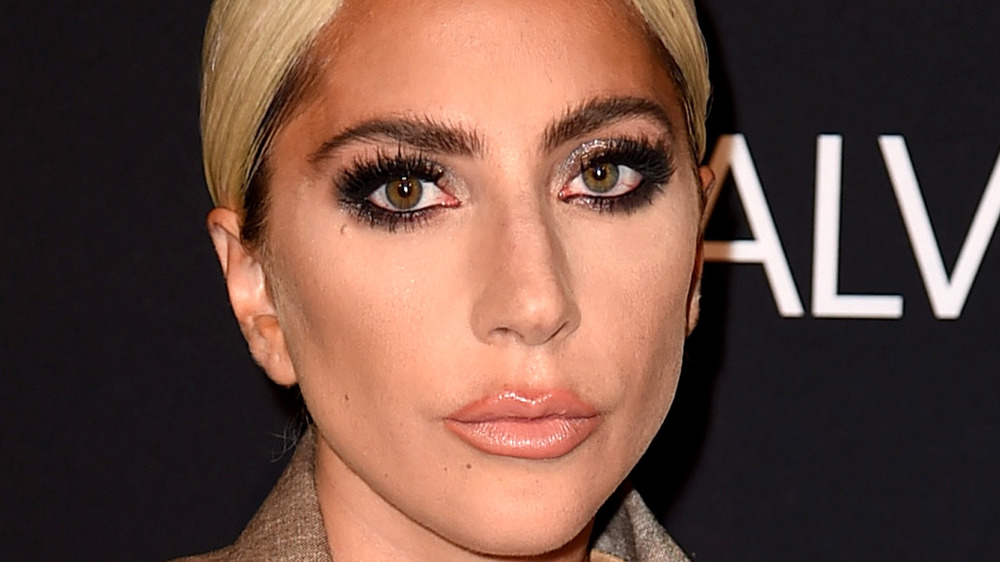 Lady Gaga looking serious with hair pulled back