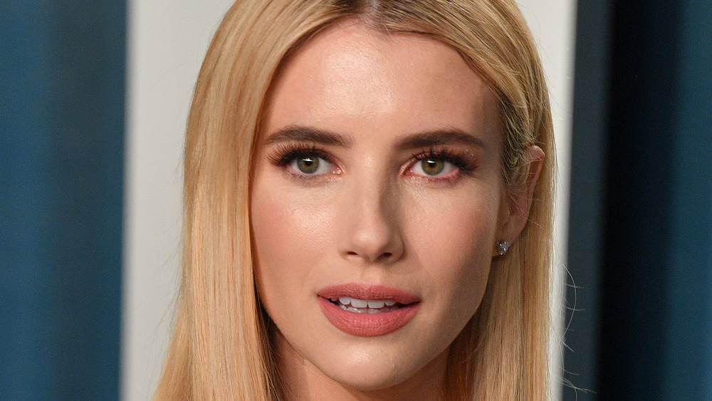 Emma Roberts smiles at event
