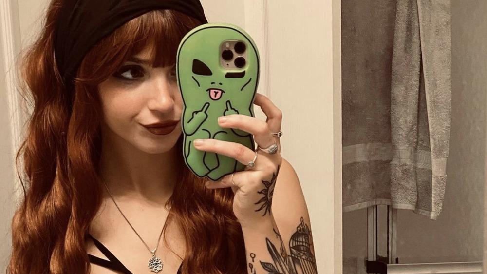 Mckayla Adkins showing her tattoos
