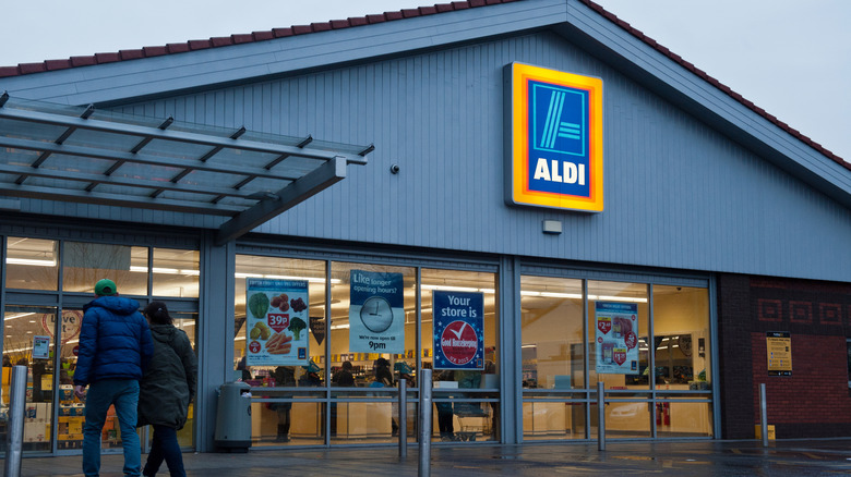 Customers entering an Aldi store