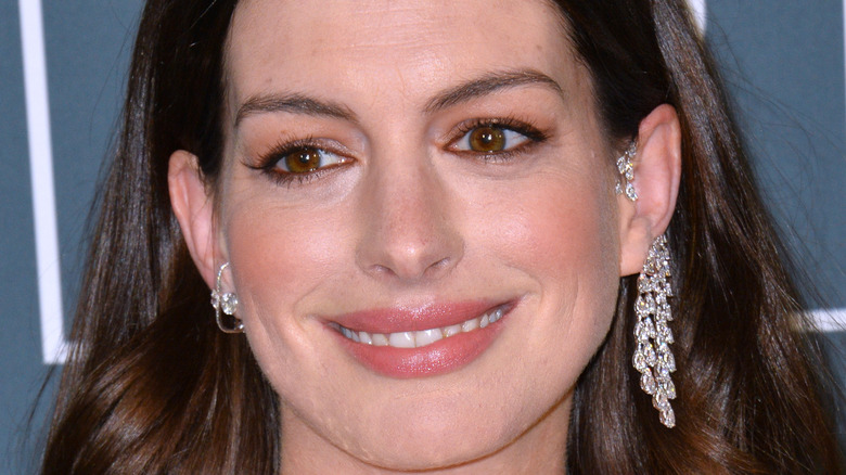 Anne Hathaway smiling on the red carpet