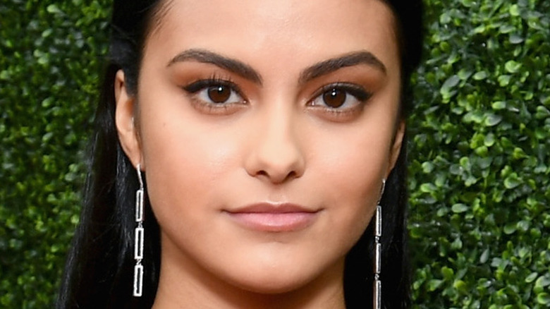 Camila Mendes poses on the red carpet