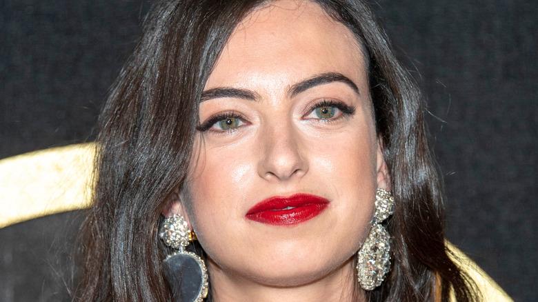 Cazzie David red lipstick smiling