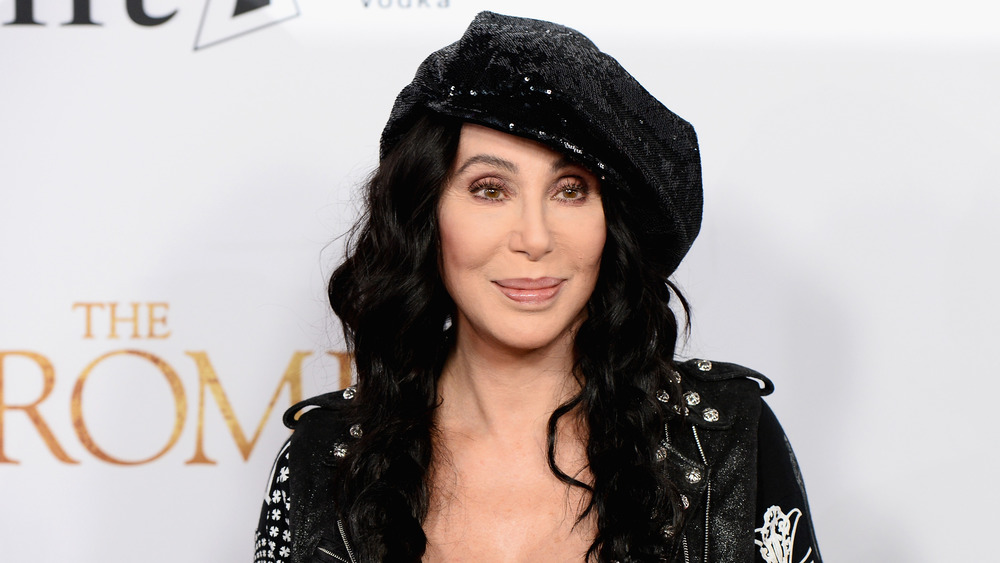 Cher in sequined hat