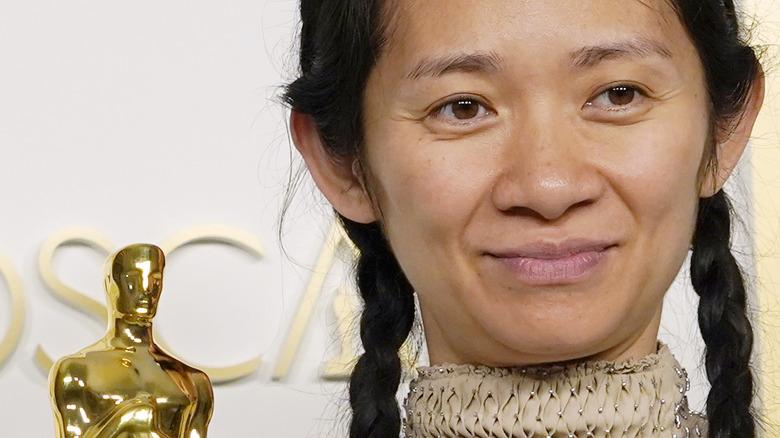 Chloe Zhao posing with Oscar