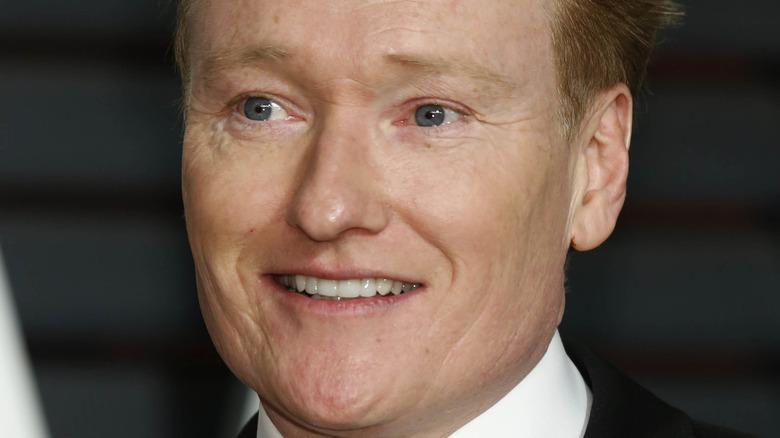 Conan O'Brien speaking at the Vanity Fair Oscar party