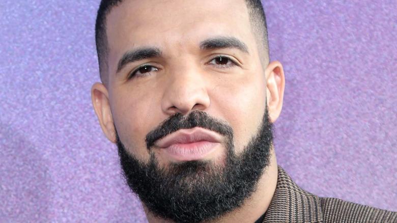 Drake posing for photo