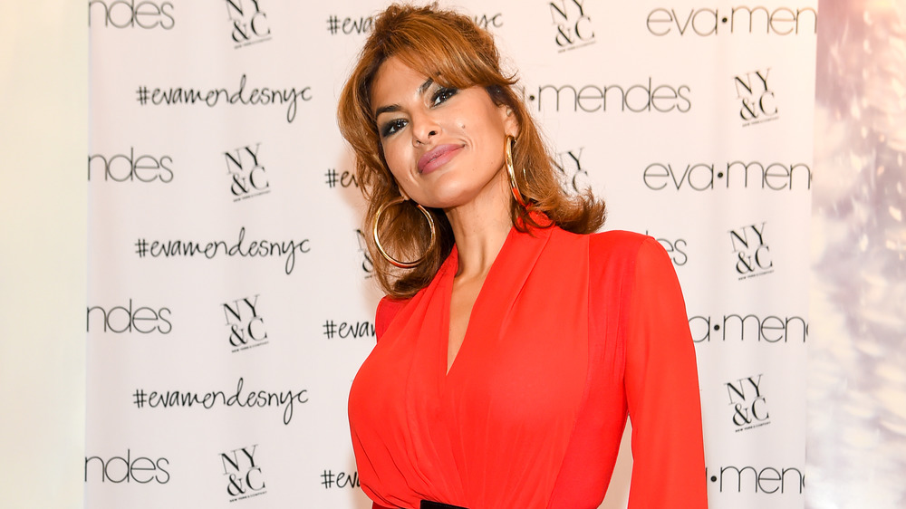 Eva Mendes smiles wearing red