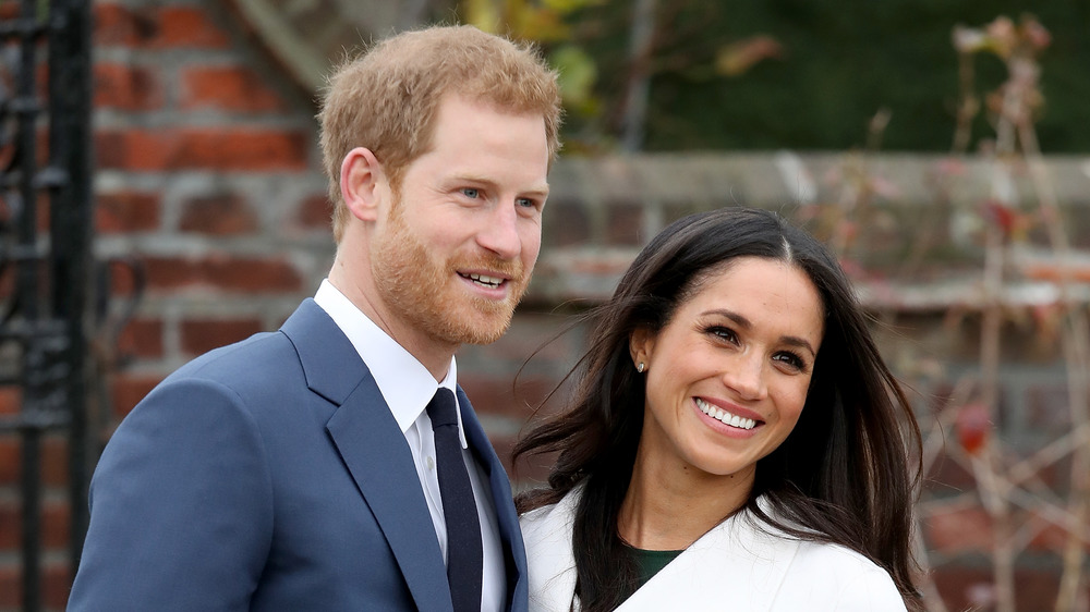 Harry and Meghan Markle smiling