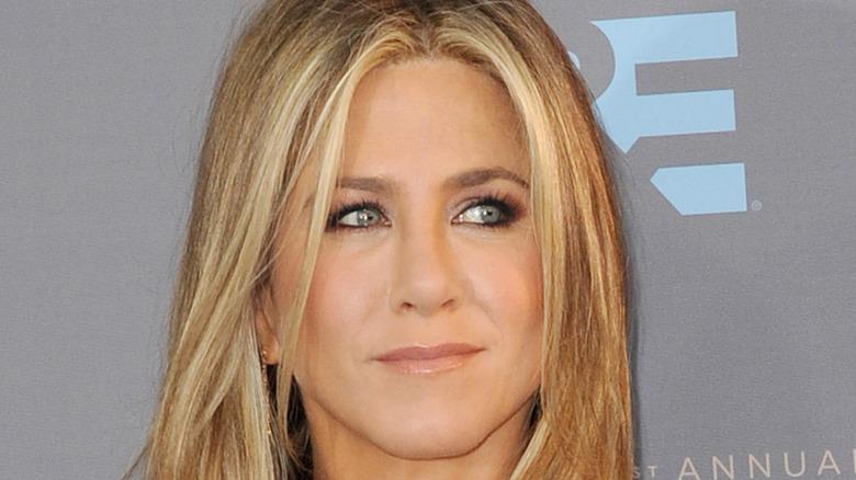 Jennifer Aniston smiling, looking sideways