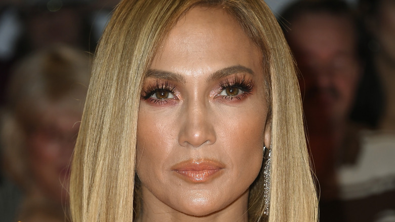 """Jennifer Lopez smoldering for cameras at an event promoting """"Hustlers"""""""