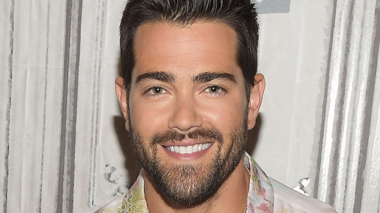 Jesse Metcalfe smiles at an event