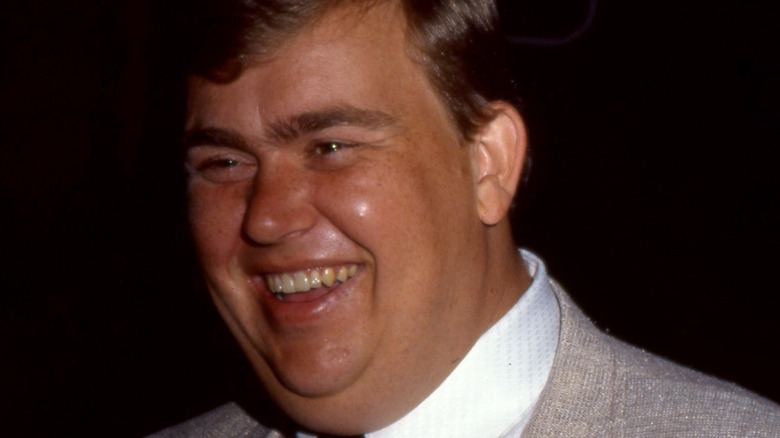 John Candy is all-smiles at an event in 1985