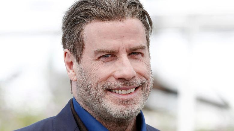 John Travolta smiling beard