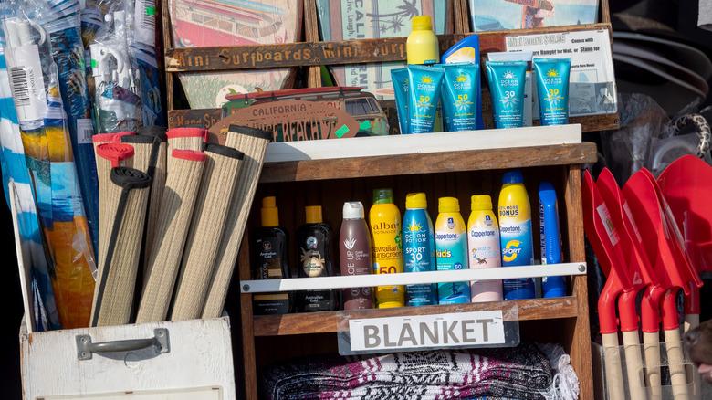 Box of summer supplies including sunscreen