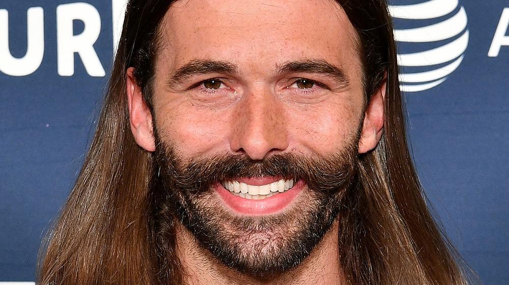Jonathan Van Ness smiles with facial hair
