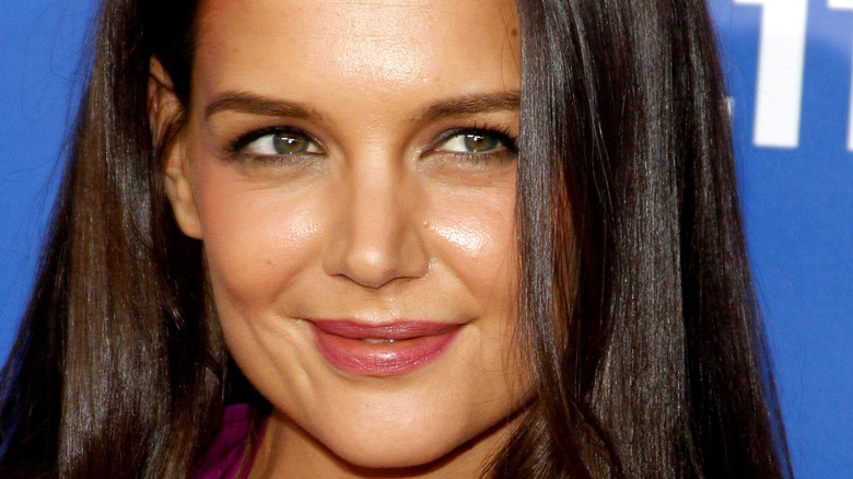 Katie Holmes wears a purple dress at an event