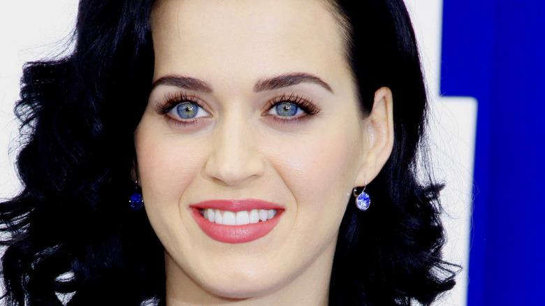 Katy Perry smiling in blue earrings