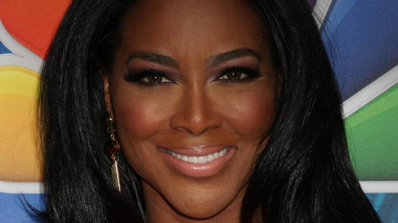 Kenya Moore smiling on red carpet
