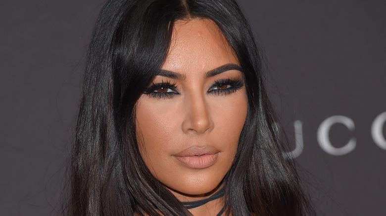 Kim Kardashian wears a black dress.