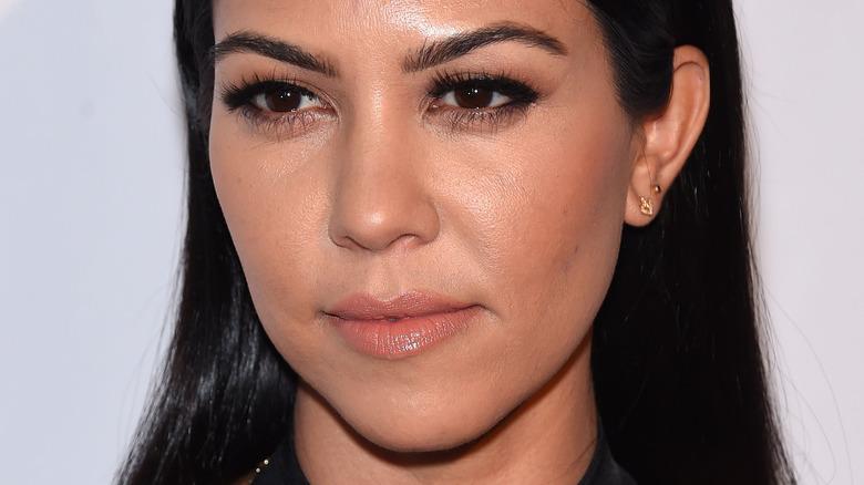 Kourtney Kardashian staring off