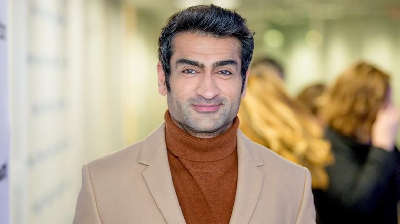 Kumail Nanjiani smiling at an event
