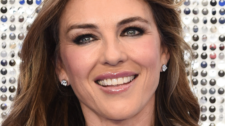 Liz Hurley poses with a smile.