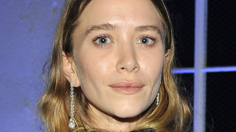 Mary Kate Olsen poses at an event