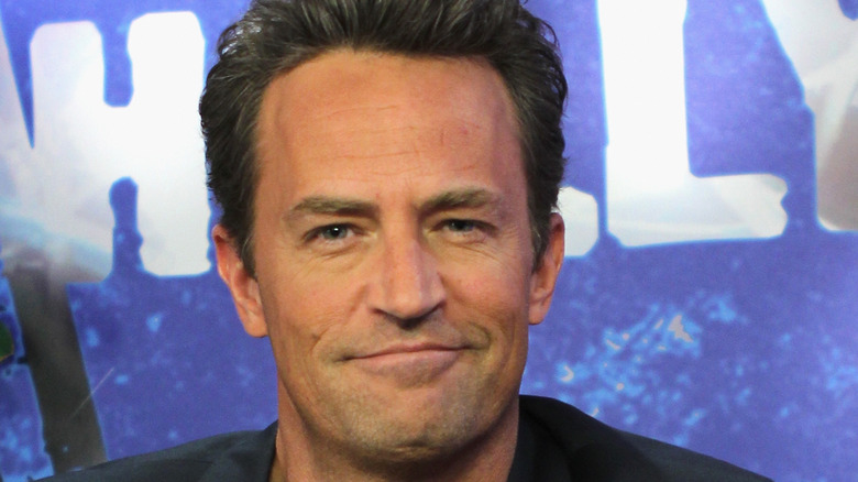Matthew Perry smiles for the camera.