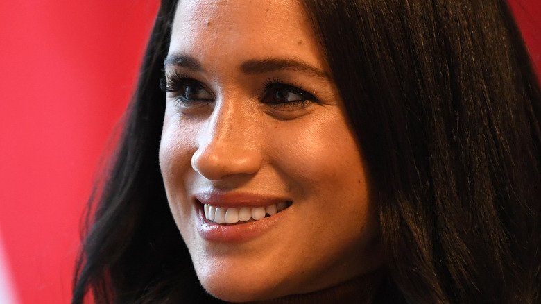 close up of Meghan Markle smiling