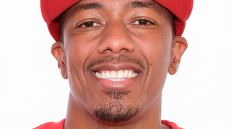 Nick Cannon smiles on the red carpet