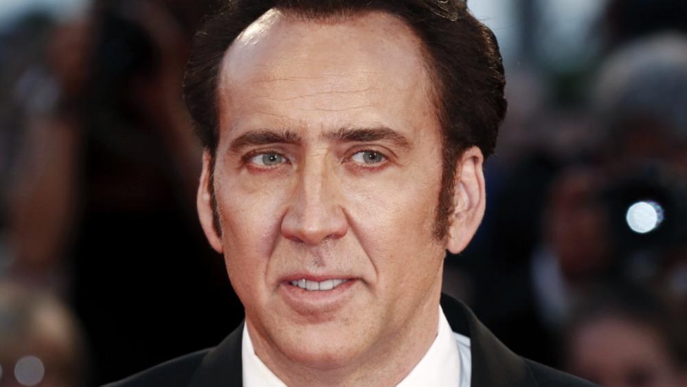 Nicolas Cage smiling film premiere