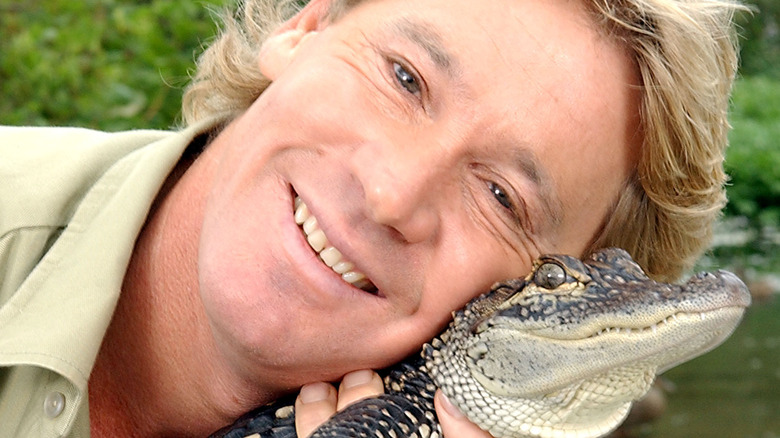 Steve Irwin poses with a crocodile