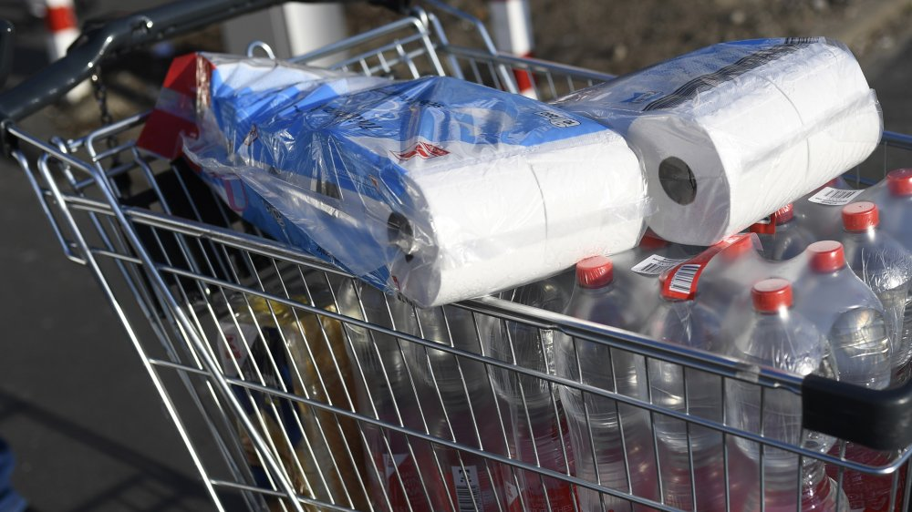 shopping cart of water and toilet paper