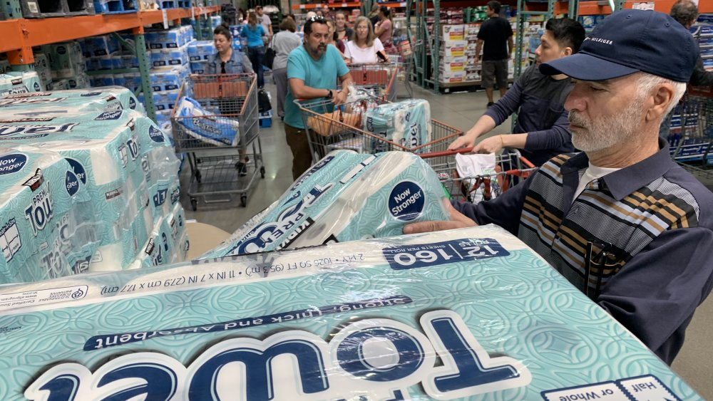 Shoppers checking out toilet paper and kitchen rolls