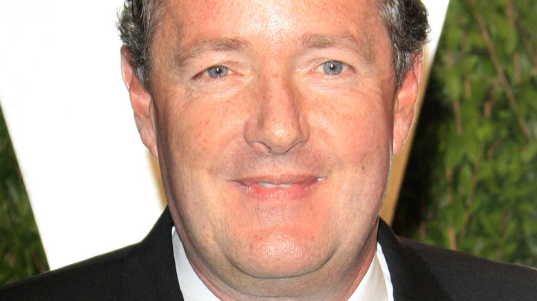Piers Morgan poses on the red carpet