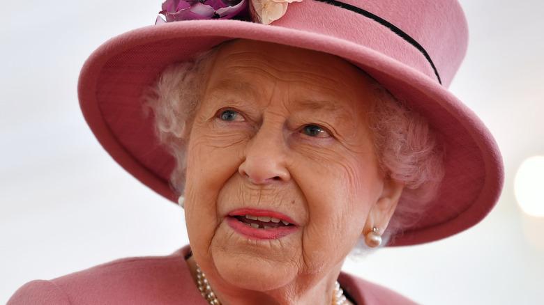 Queen Elizabeth wearing flower hat